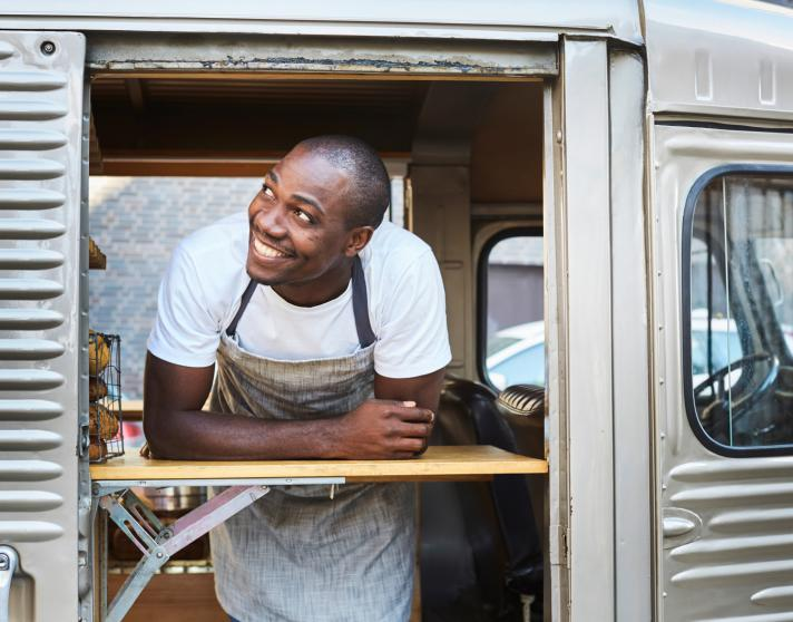 Man smiling in food truck